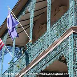 very ornate wrought iron railing on porch