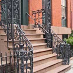 wrought iron railing on front porch steps