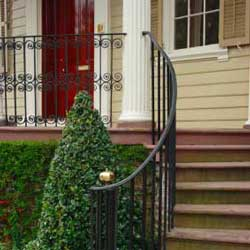 curved wrought iron railing along steps of front porch