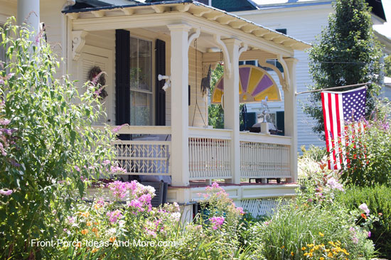 combination of porch railing designs on colorful front porch