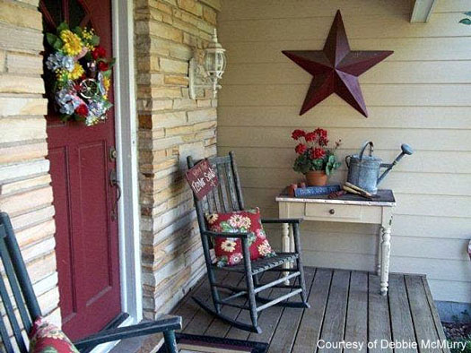 porch rocking chair at Debbie's home with a red and yellow sunflower pillow