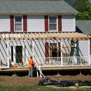 building contractors constructing front porch