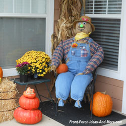 porch scarecrow in farmer's jeans
