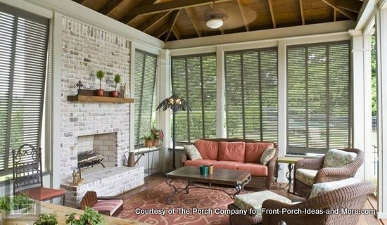 One of The Porch Company's beautiful custom screened porches with porch shutters to help with sunlight