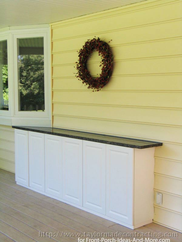 granite topped storage cabinet on front porch