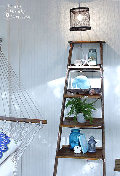 old rickety ladder turned into classy shelf for porch