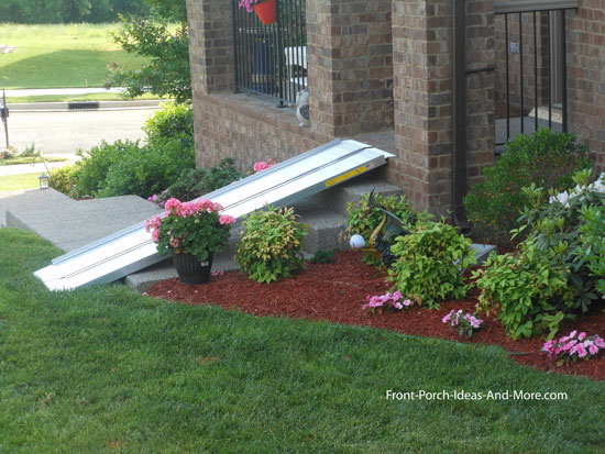 portable aluminum wheelchair ramp leading to front porch