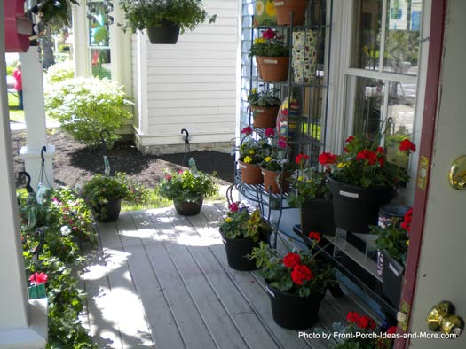 beautiful array of planters on front porch