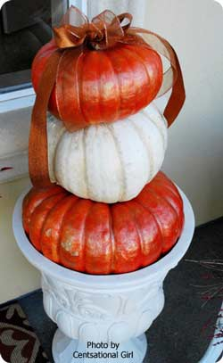 stacked and decorated pumpkins