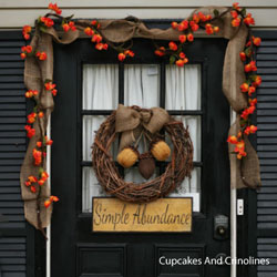 pumpkin garland over front door on porch