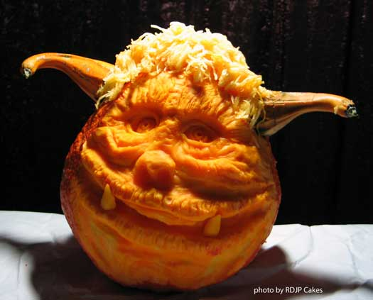 a happy ogre-looking carved pumpkin