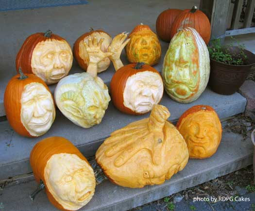 collection of intricately carved pumpkins for halloween