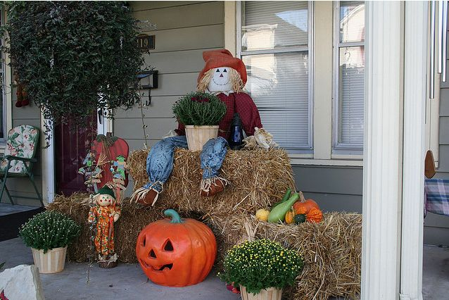 Beautiful Autumn decorated porch with whimiscal scarecrow