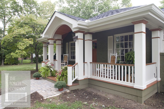 lovely ranch home front porch with white rocking chair