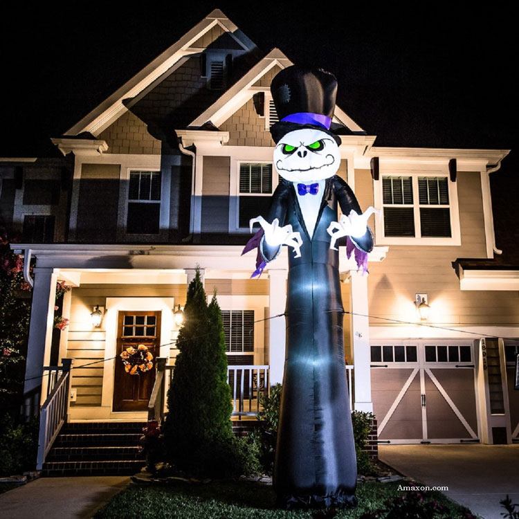 grim reaper inflatable in front yard at Halloween