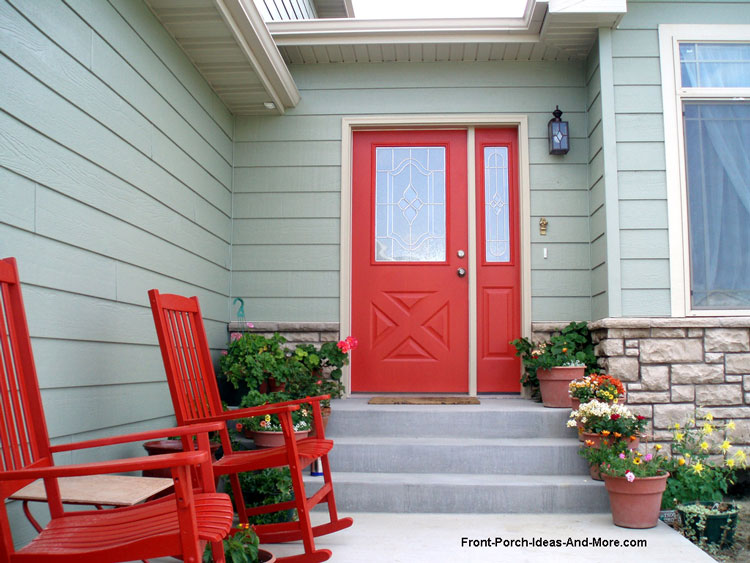 radiant red front door and rocking chairs