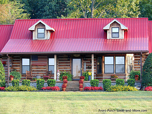 log cabin with red metal roof