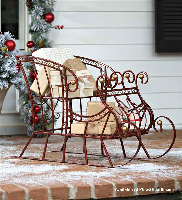 red metal sleigh decoration on porch