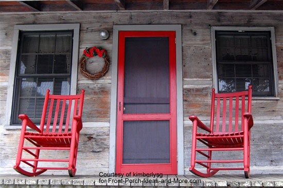 Porch with red rockers and red screen door
