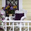 white wicker rocking chairs on front porch