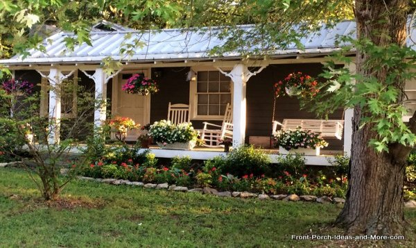 summer porch with rocking chairs and porch swing