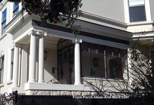 front porch with iconic columns and enclosed porch
