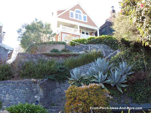 Dramatic landscaping and walkway to front porch