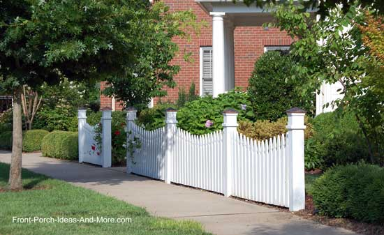scalloped fence design as focal point for landscaping