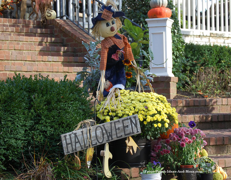 autumn floral display with scarecrow and Halloween sign