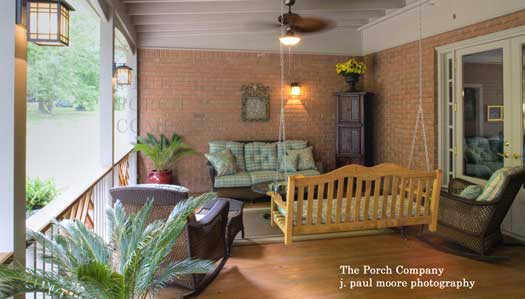 a beautifully decorated screened porch