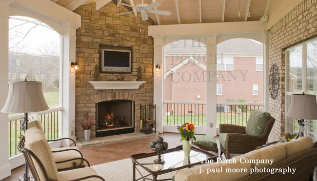 custom screen porch with fireplace and flat screen tv