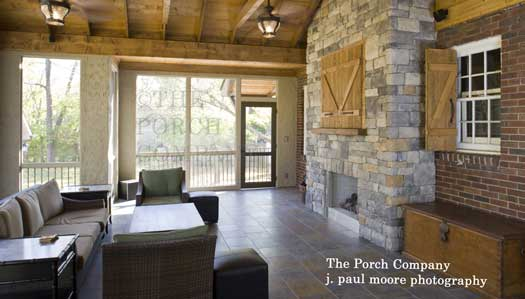 enclosed porch with stone fireplace