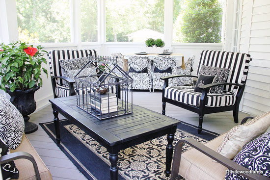 screened back porch decorated for spring
