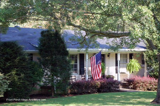 shed style porch roof on brick ranch home