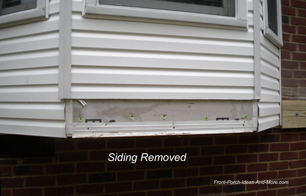 siding removed for ledger board installation