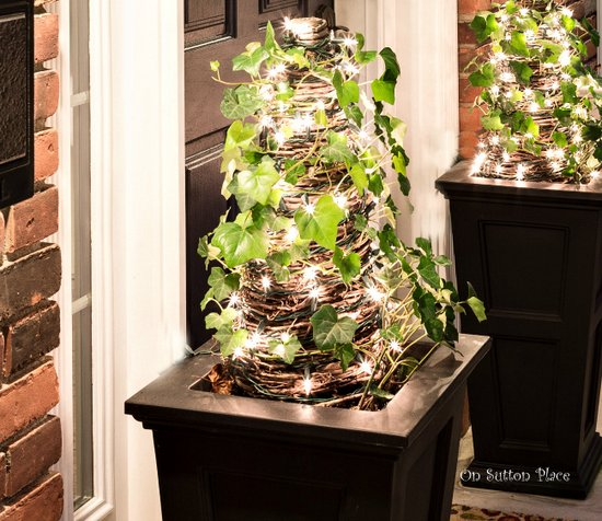 simple outside christmas decor - On Sutton Place - lighted topiaries