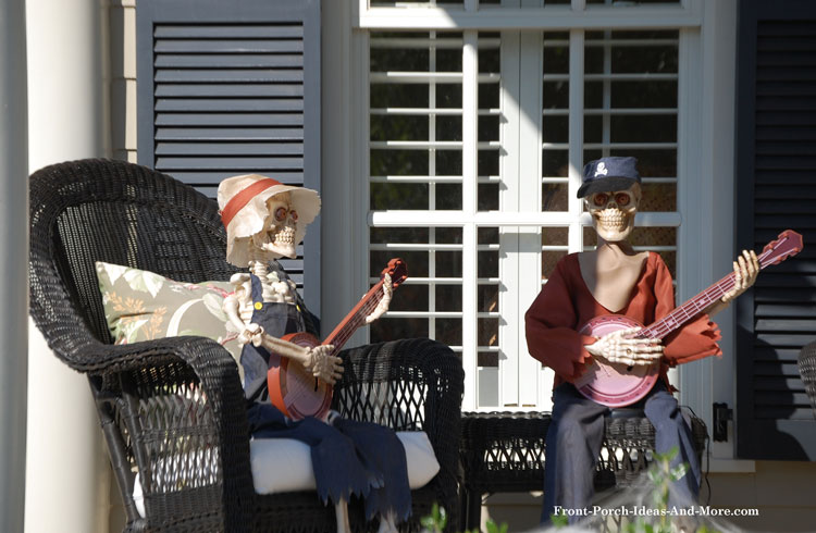 two skeletons playing banjos on the porch