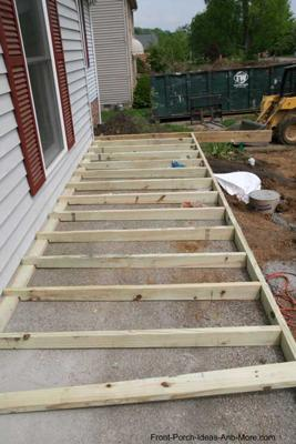 sleepers construced over top of concrete for front porch