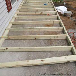 joists being installed on concrete porch floor