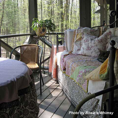 comfortable bed on porch