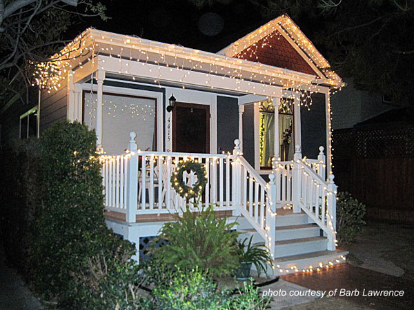small front porch and home decorated with christmas lights