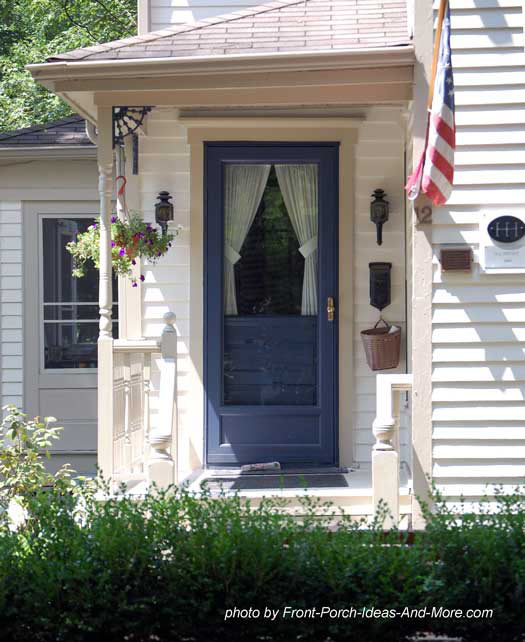 small porch with striking blue front door