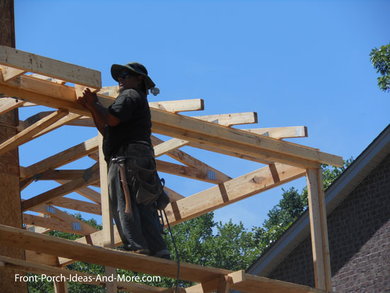 soffit framing being installed along front porch roof