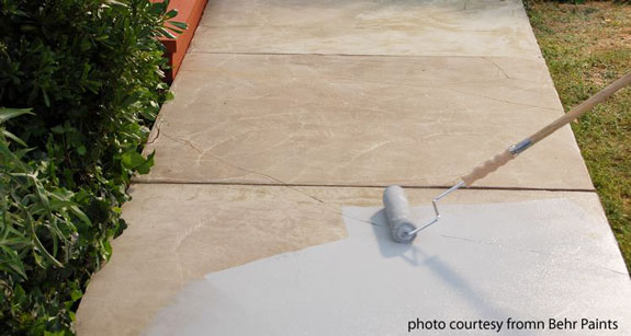 solid color being applied to concrete walkway