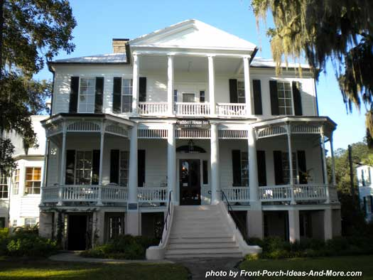 typical southern grand front porch with sweeping staircase
