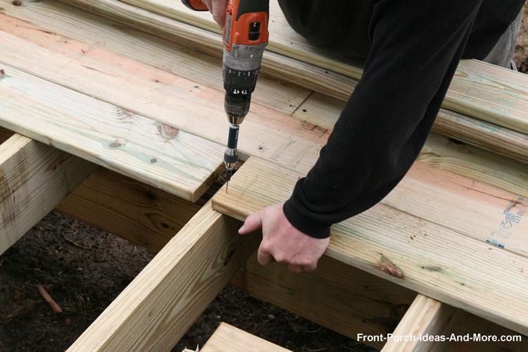 Southern Yellow Pine being installed on new front porch - Wood Porch Flooring Tongue And Groove Decking