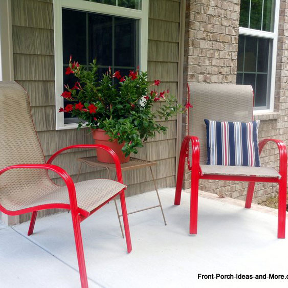 two porch chairs painted with red spray paint
