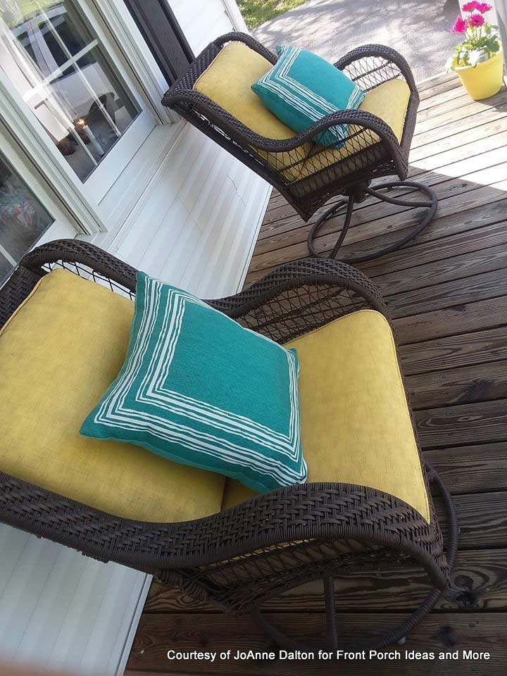 spray-painted cushions on front porch