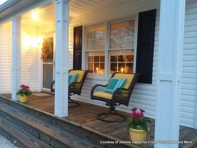 Front porch with cushions that are spray painted yellow
