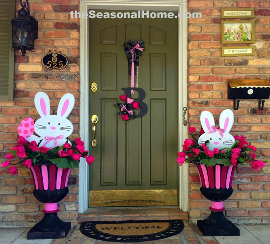 front door with initial wreath and cute bunnies on either side